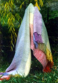 a rainbow colored hand woven mohair throw