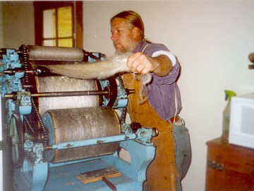 Stan at the carding machine